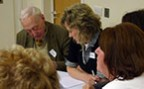 Older patients and staff working together at a co-design event